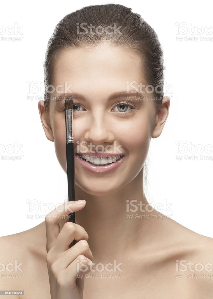 Young woman with brush for makeup royalty-free stock photo