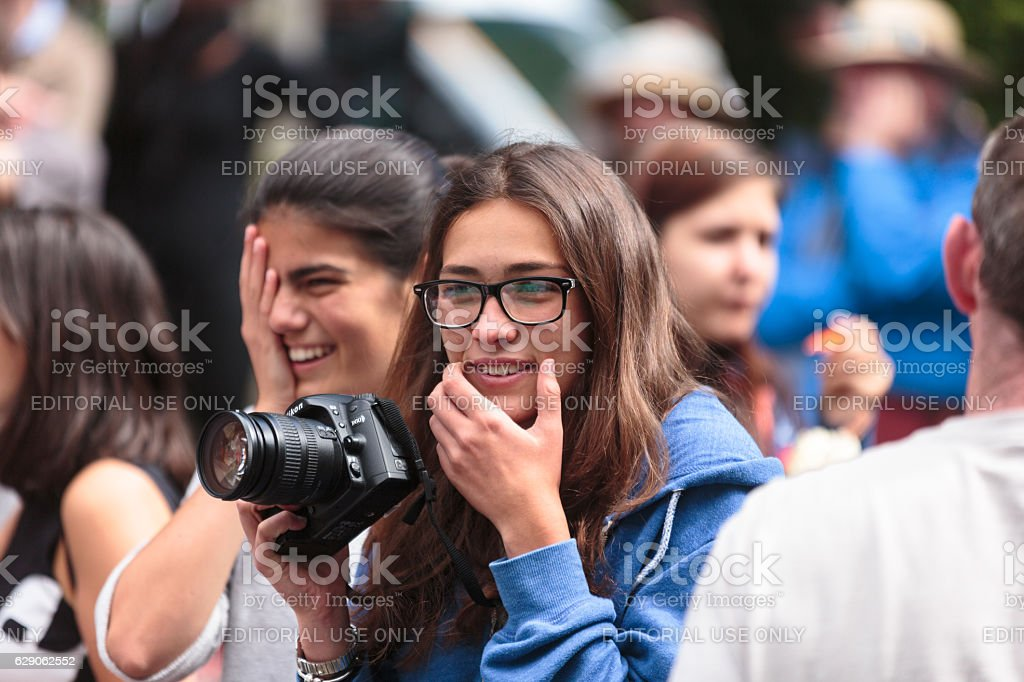 Young woman with camera at open air community event stock photo