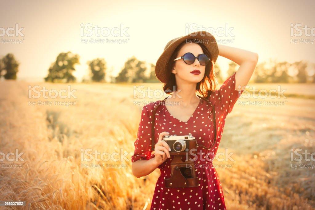 young woman with camera - foto de acervo