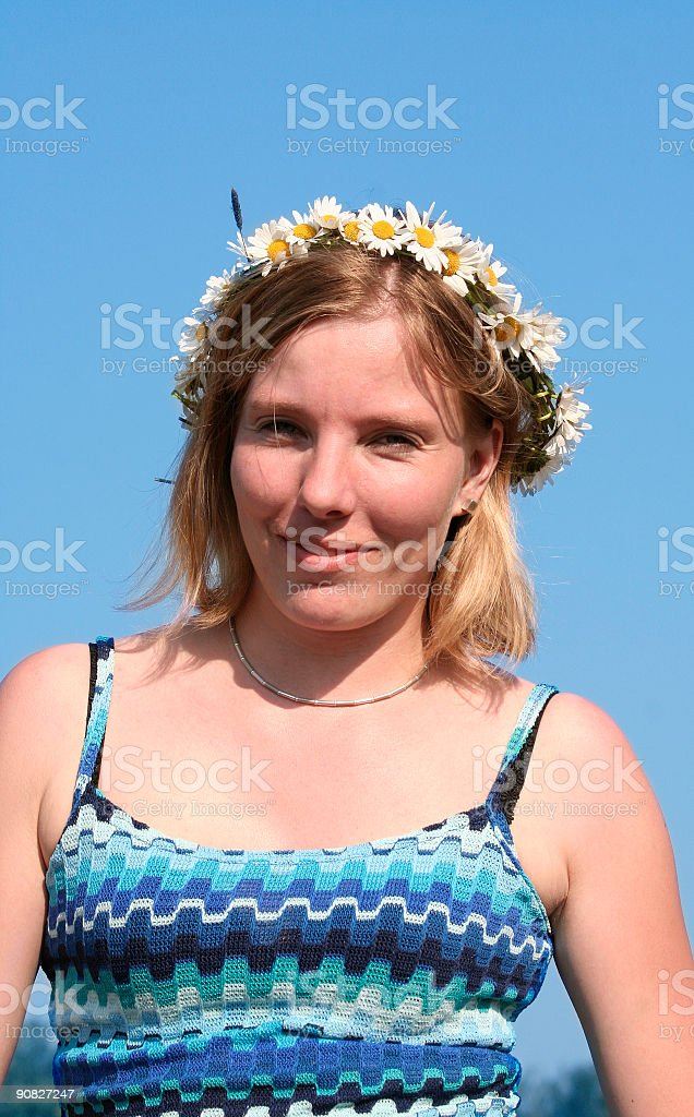 young woman with camomile wreath on blue sky royalty-free stock photo