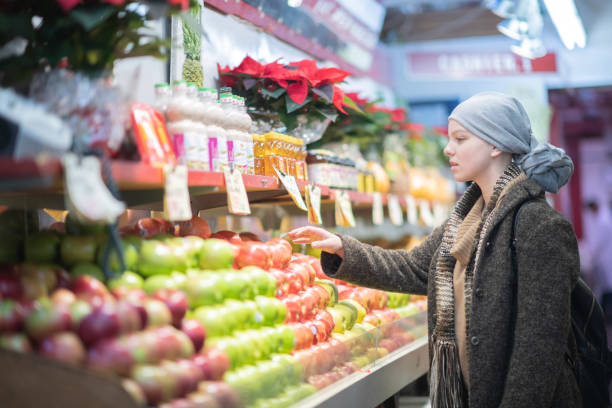 Young Woman With Cancer Grocery Shopping stock photo stock photo