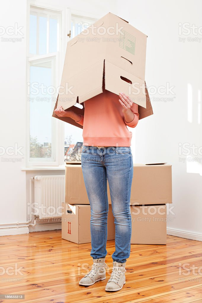Young woman with cardboard on head royalty-free stock photo