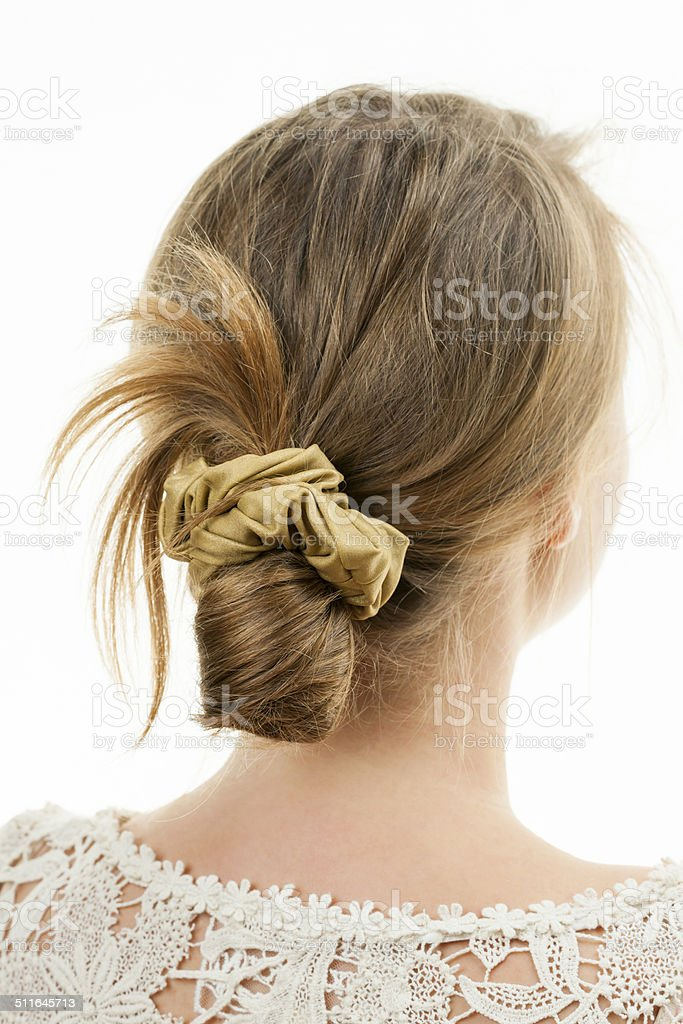Young woman with casual messy bun hairdo stock photo