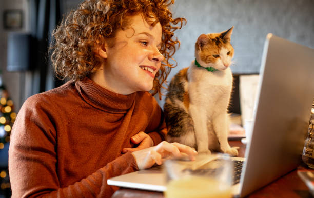 Young woman with cat using laptop picture id1217462491?b=1&k=6&m=1217462491&s=612x612&w=0&h=f4kcprxgshcn8z1oiqm8 0hsrigskojzrm9q4cgjyds=