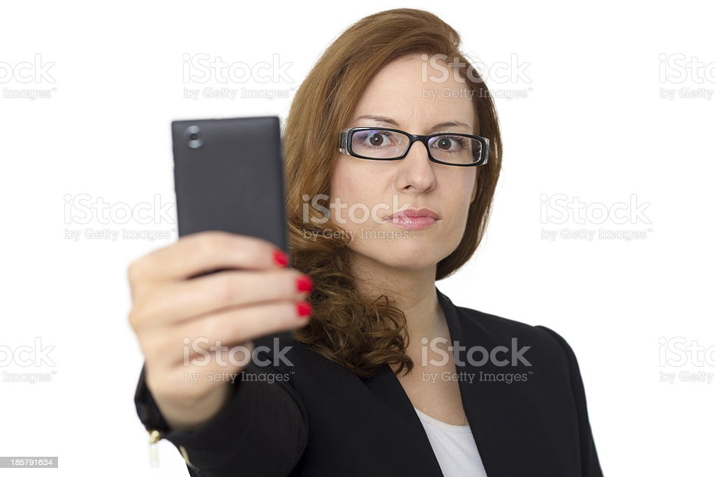 Young Woman with cell phone walking royalty-free stock photo