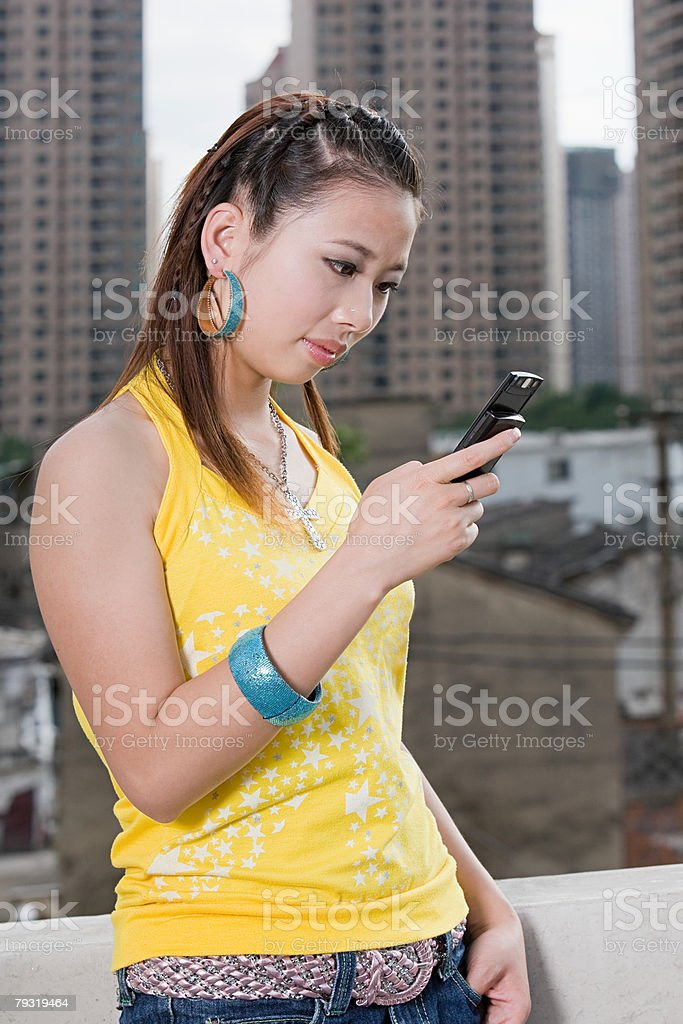 Young woman with cellphone 免版稅 stock photo