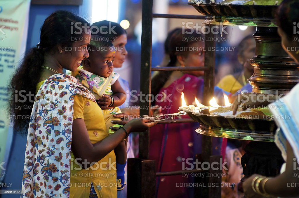Young woman with child in the temple stock photo