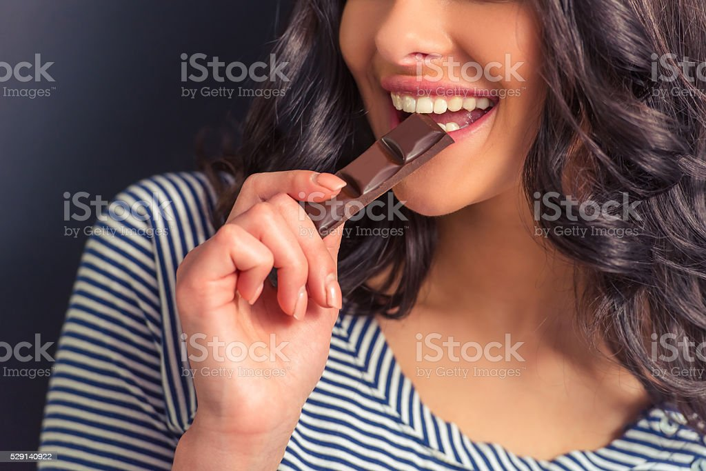 Young woman with chocolate stock photo