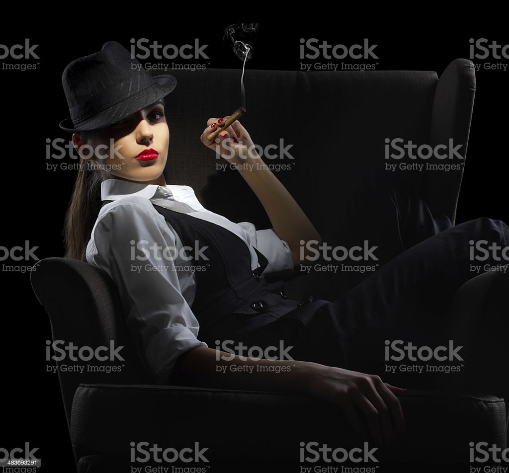 Young woman with cigar sit on chair stock photo