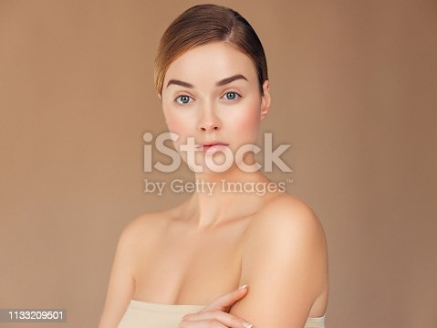 istock Young woman with clean and fresh skin 1133209501