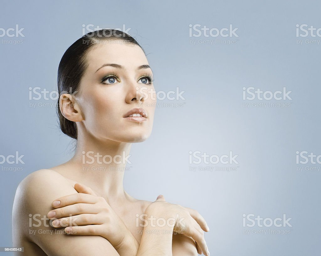 A young woman with clear skin posing for a beauty portrait royalty-free stock photo