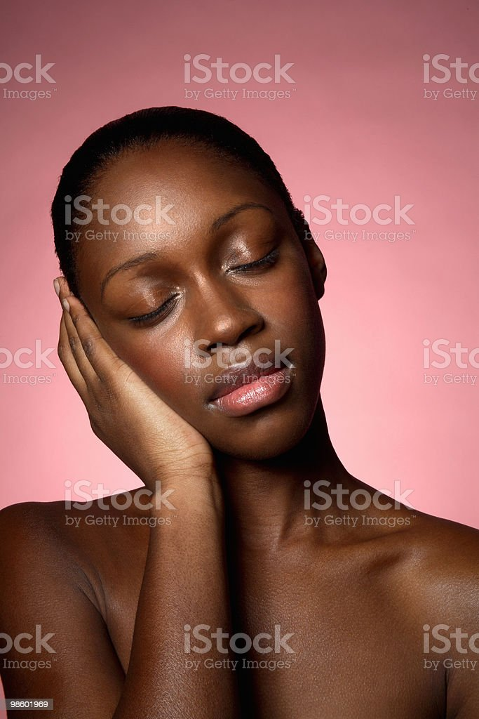 Young woman with closed eyes resting head on hand royalty-free stock photo