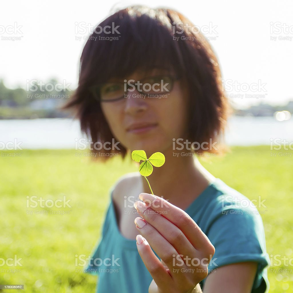 Young woman with clover in her hand royalty-free stock photo