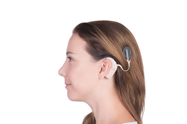 Young woman with cochlear implant Young woman with cochlear implant close up implant stock pictures, royalty-free photos & images