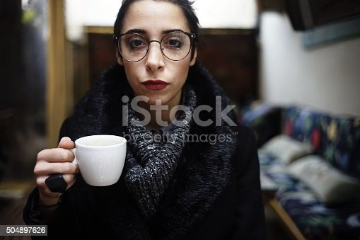 531098549istockphoto young woman with coffee cup 504897626