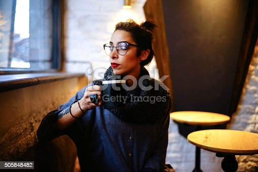 531098549istockphoto young woman with coffee cup 505848482