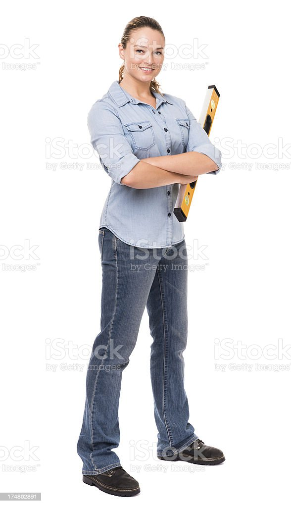 Young Woman with Construction Level Isolated on White Background royalty-free stock photo