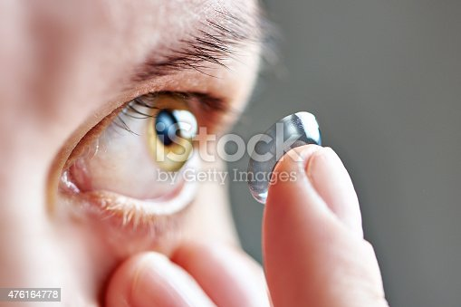 istock Young woman with contact lens 476164778