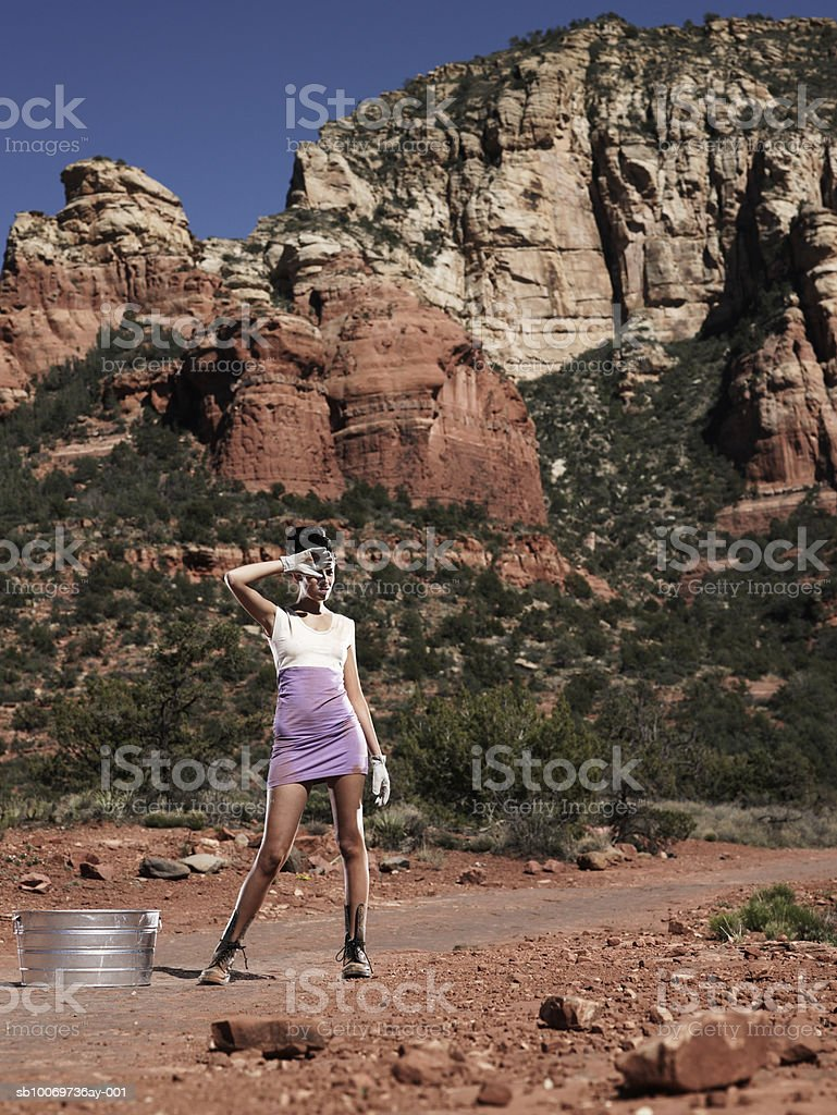 Young woman with container in desert 免版稅 stock photo