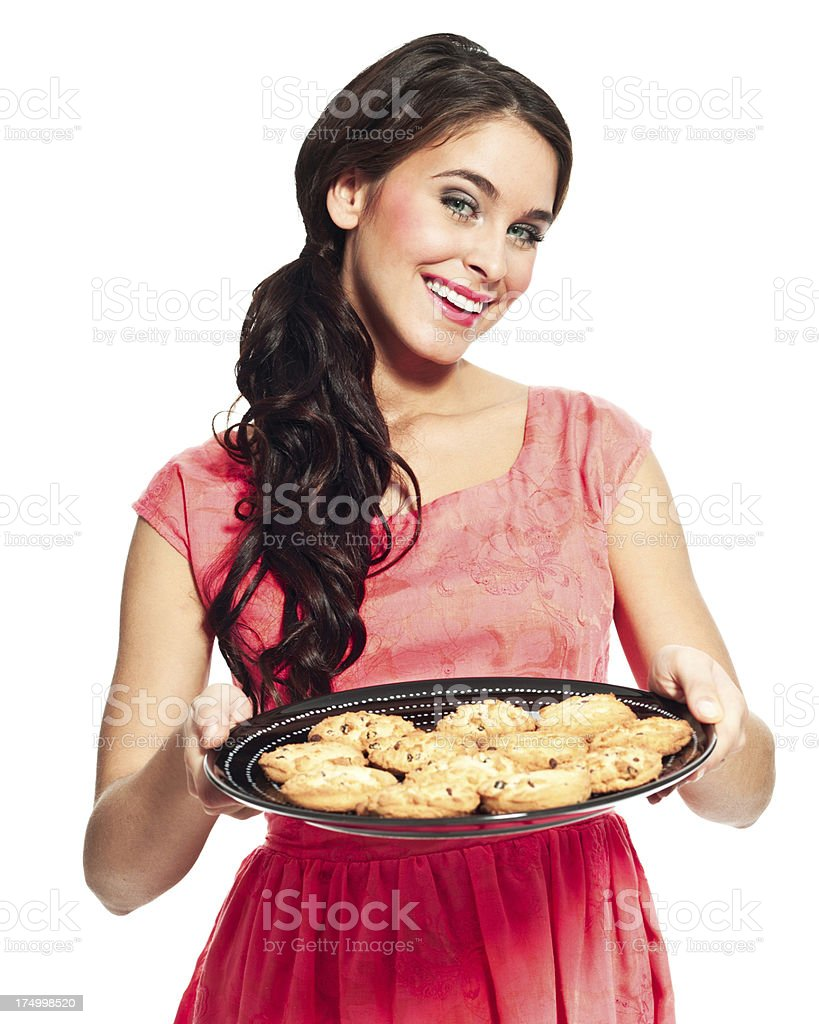 Young woman with cookies Portrait of cheerful woman a tray with cookies and smiling at the camera. 20-24 Years Stock Photo