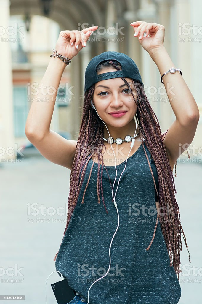 young woman with cornrows dancing on the street stock photo