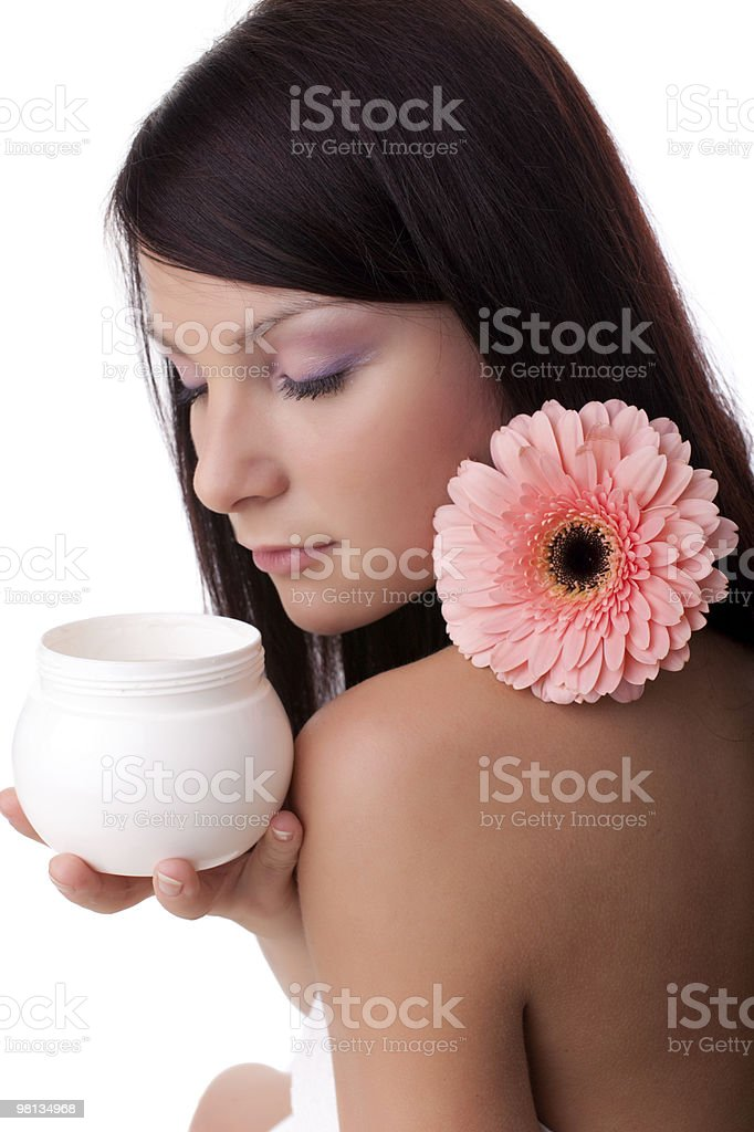 Young woman with cosmetic cream royalty-free stock photo