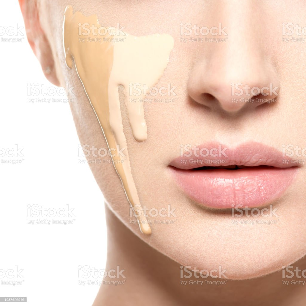 Young woman with cosmetic foundation on skin. stock photo