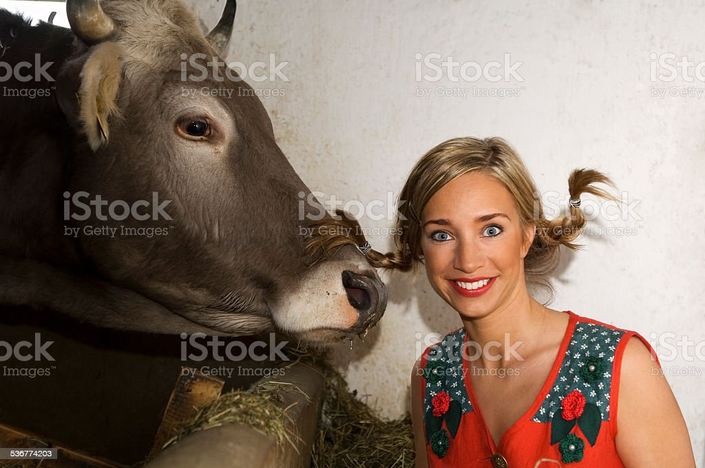 Young woman with cow, portrait