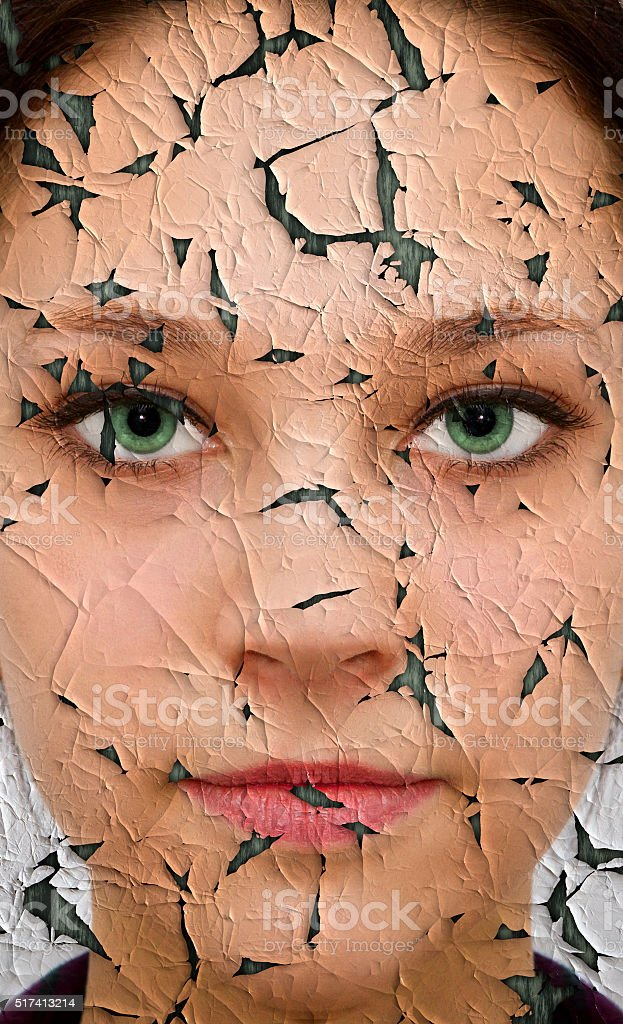 Young woman with cracked face stock photo