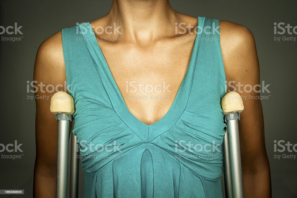 young woman with crutches royalty-free stock photo