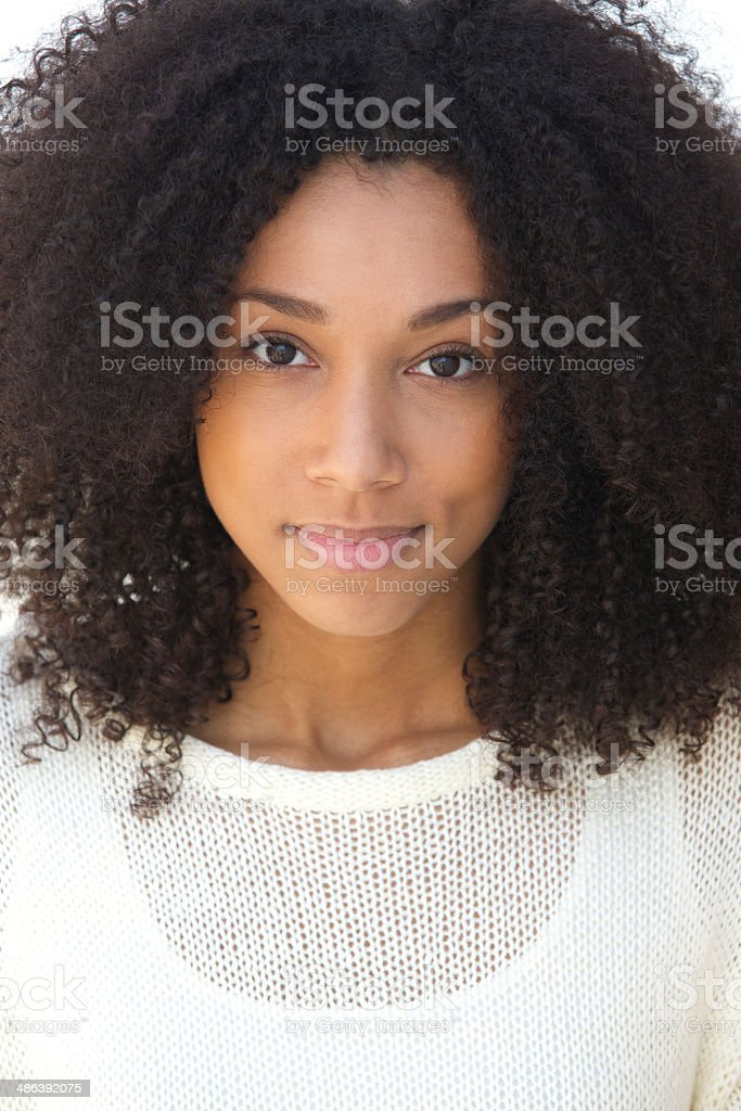 Young woman with curly hair grinning stock photo