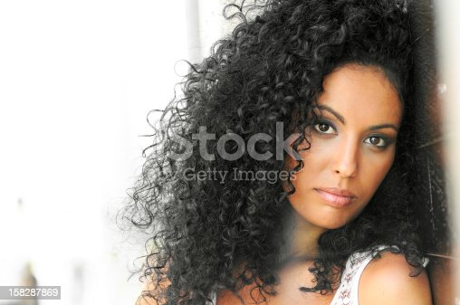 istock Young woman with curly hairstyle 158287869