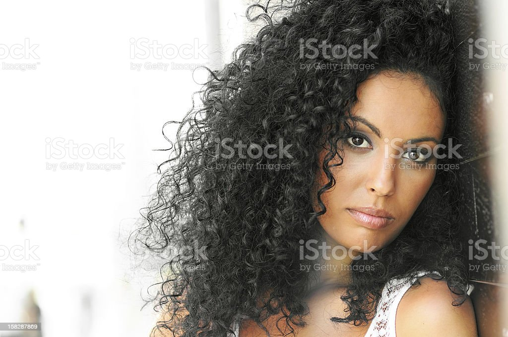 Young woman with curly hairstyle stock photo