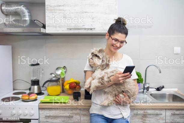 Young woman with cute dog in kitchen picture id692868844?b=1&k=6&m=692868844&s=612x612&h=yo2r6v2xyubcdqsou4qfdreyah5zif 3k9mv7ktqitk=