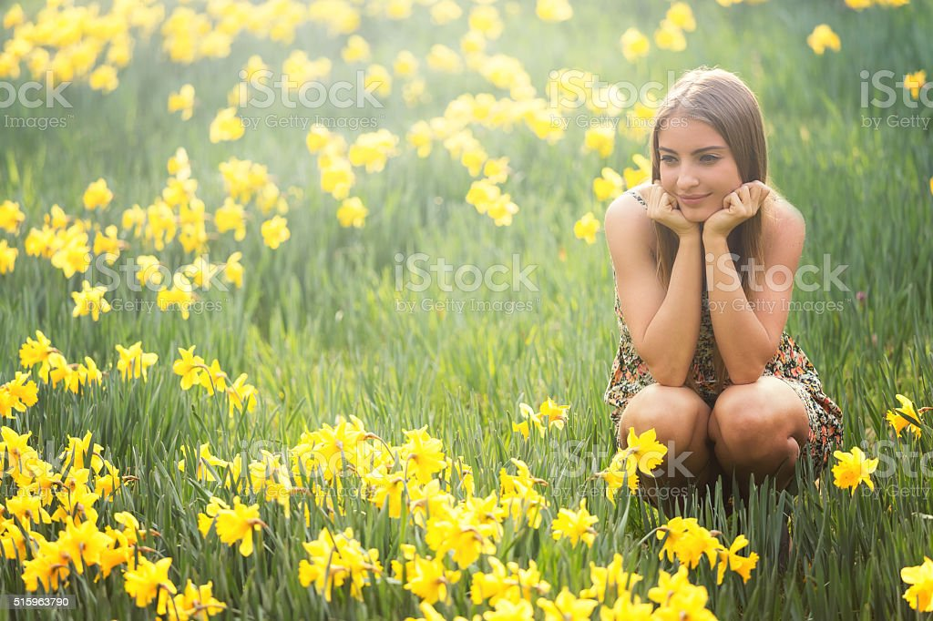 young woman with daffodils stock photo