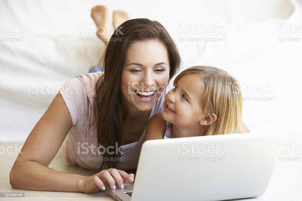 Young woman with daughter using laptop computer royalty-free stock photo