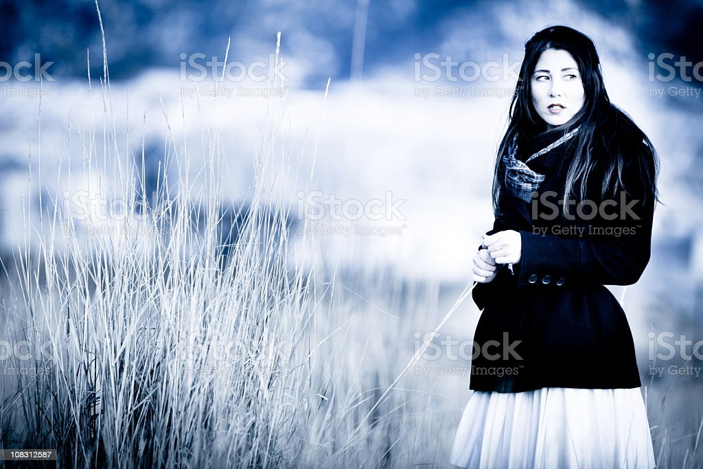 Young Woman With Deep Thoughts in a Meadow royalty-free stock photo