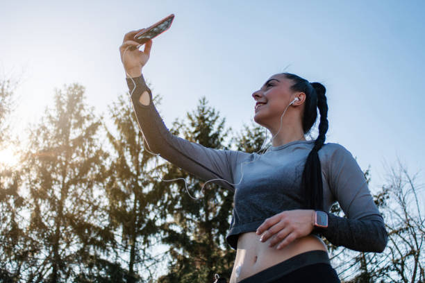 Young woman with diabetes taking a selfie stock photo