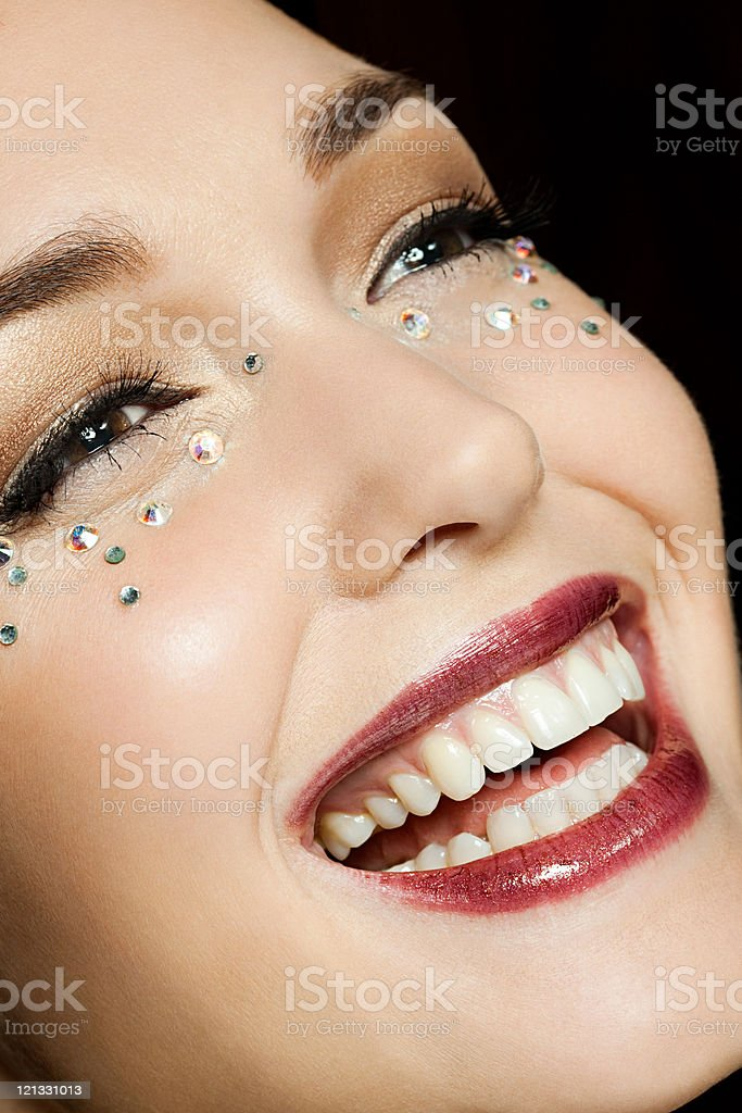 Young woman with diamonds on face, portrait royalty-free stock photo