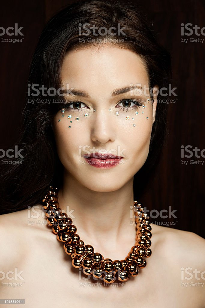 Young woman with diamonds on face, portrait stock photo