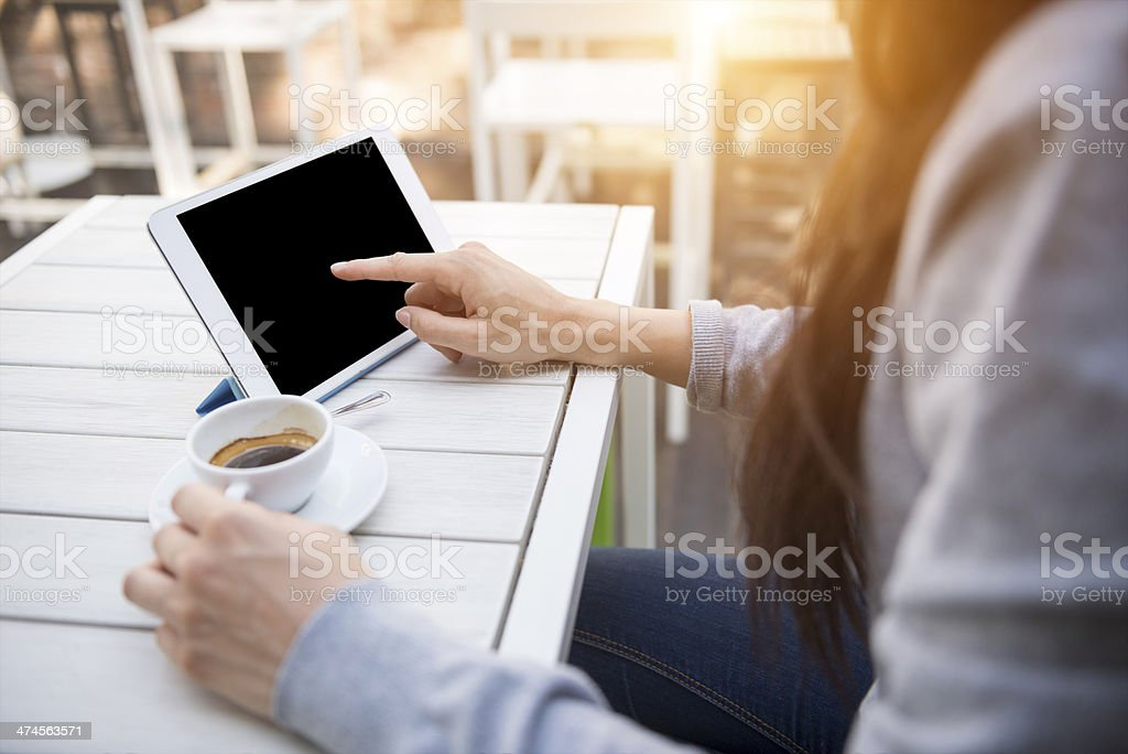 Young woman with digital tablet at the cafè stock photo