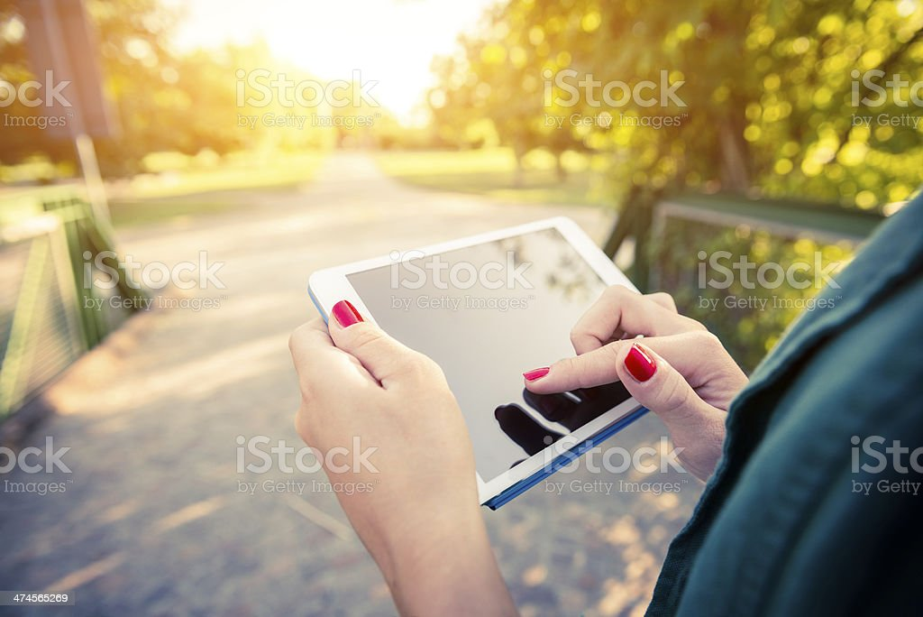 Young woman with digital tablet in the city royalty-free stock photo