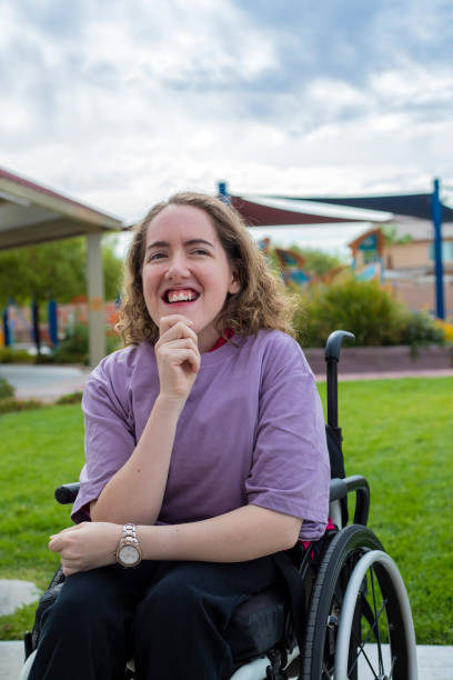 A young woman with disabilities in a wheelchair stock photo