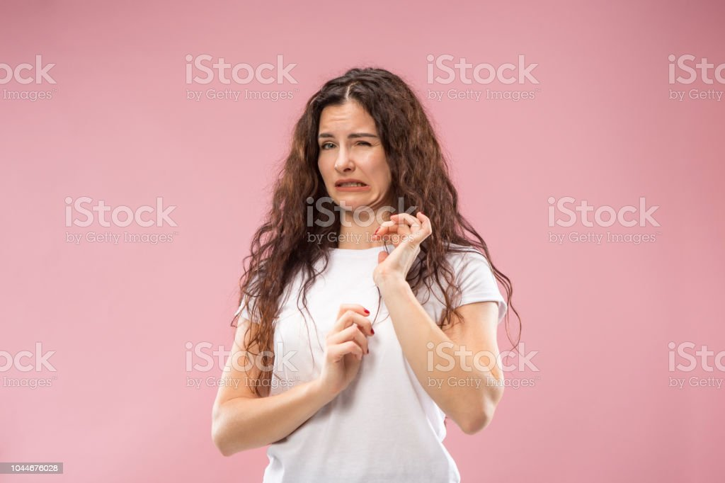 Young woman with disgusted expression repulsing something, isolated on the pink Ew. It's so gross. Young woman with disgusted expression repulsing something. Disgust concept. Young emotional woman. Human emotions, facial expression concept. Studio. Isolated on trendy pink color Adult Stock Photo