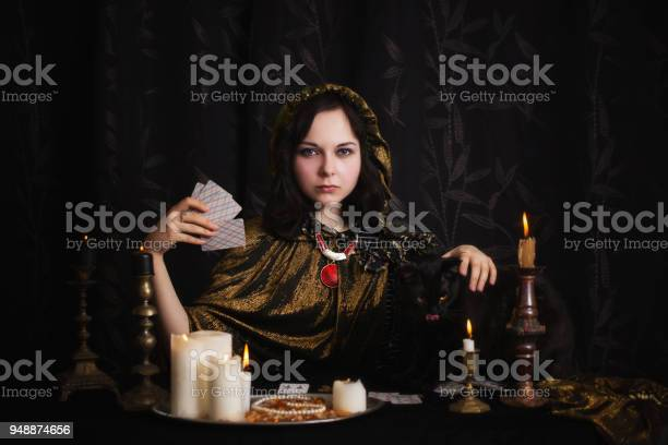 Young woman with divination cards in room picture id948874656?b=1&k=6&m=948874656&s=612x612&h=yqp2ptvf izbnfuah6p7tutg7nxrh aelkws4f6xks0=