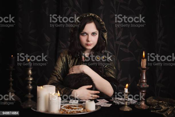 Young woman with divination cards in room picture id948874684?b=1&k=6&m=948874684&s=612x612&h=m8c9nrnkp7ooir8hk4q4m7r73pobktd6yiwra1lseoe=
