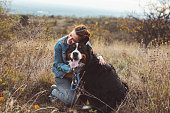 istock Young woman with dog 1060528884