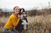 istock Young woman with dog 1060528954
