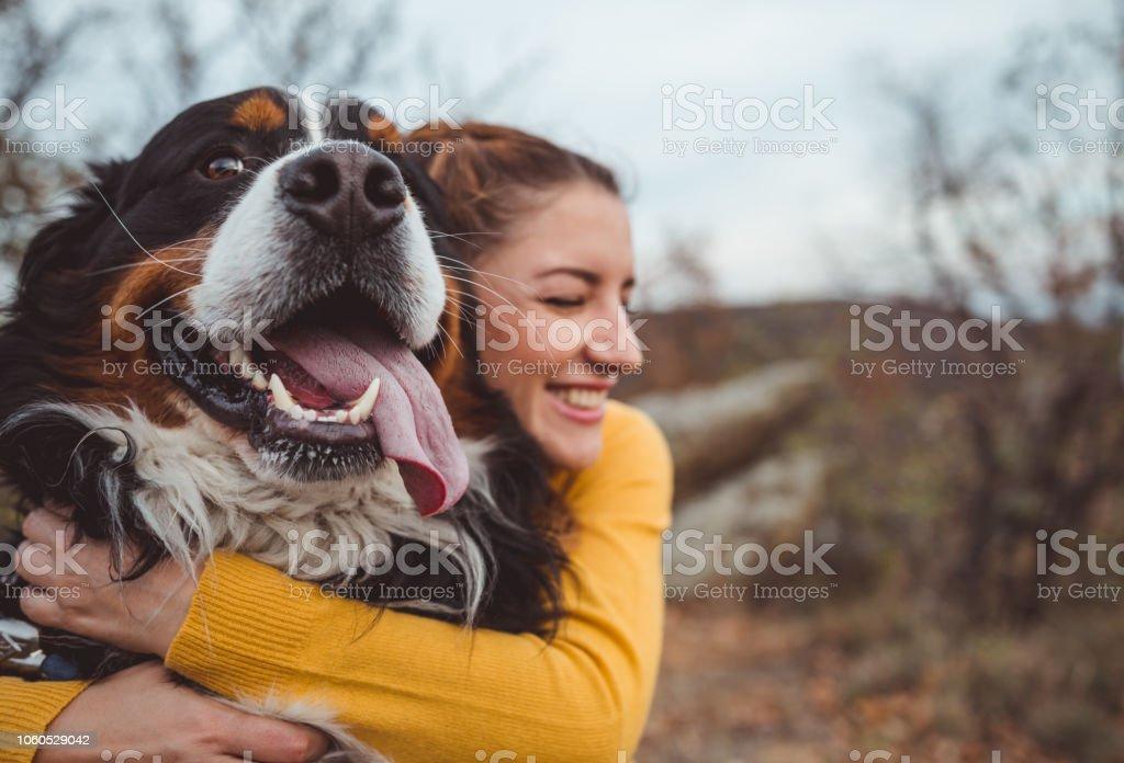 Young woman with dog Young woman with dog Adult Stock Photo