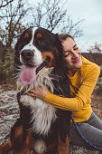istock Young woman with dog 1060529170